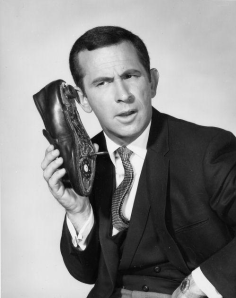 TV's Maxwell Smart, Agent 86 (played by Don Adams) on his Shoe Phone.