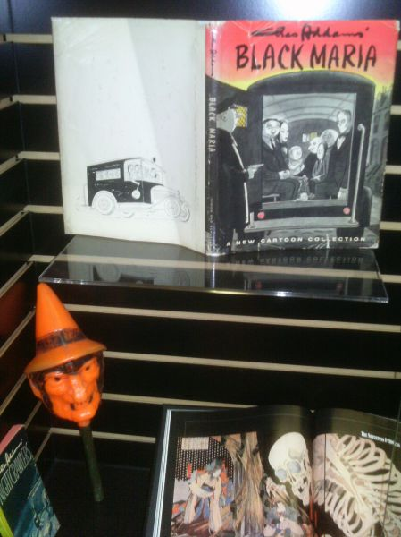 Charles Addams books, a witch rattle and some Japanese skeleton art.